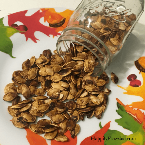 How to separate and roast pumpkin seeds for a fun fall and halloween snack. | HappilyFrazzled.com