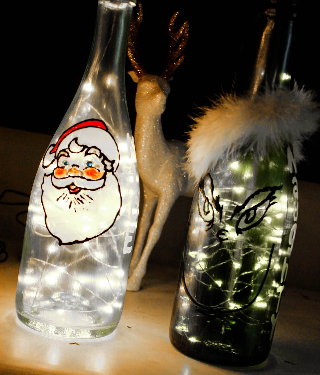 Christmas Painted Wine Bottles by Atlanta style blogger Happily Hughes