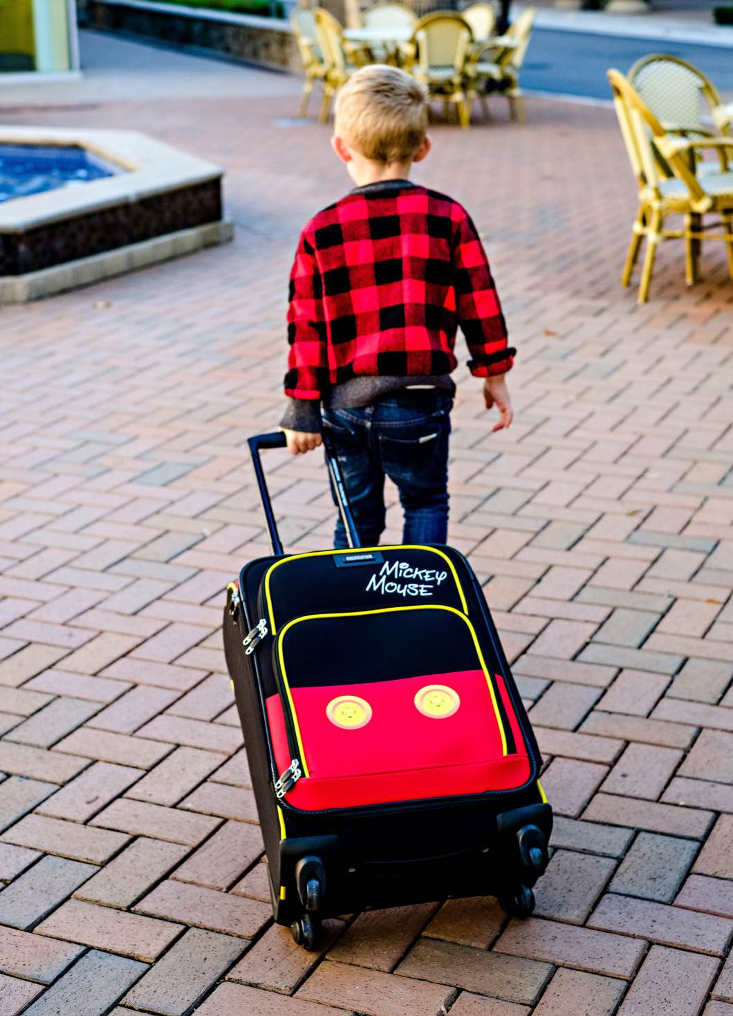 Flying with Children - What to Pack by Atlanta mom blogger Happily Hughes