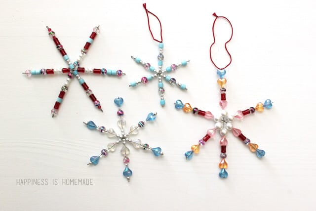 Christmas Craft for Kids: Colorful Beaded Snowflake Ornaments on a white background