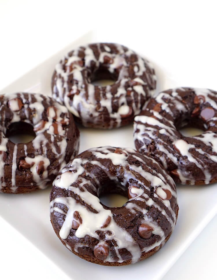 Healthy Double Chocolate Donuts are Under 100 Calories Each - These better-for-you double chocolate donuts are under 100 calories each! A moist and rich chocolaty indulgence that won't blow your diet!