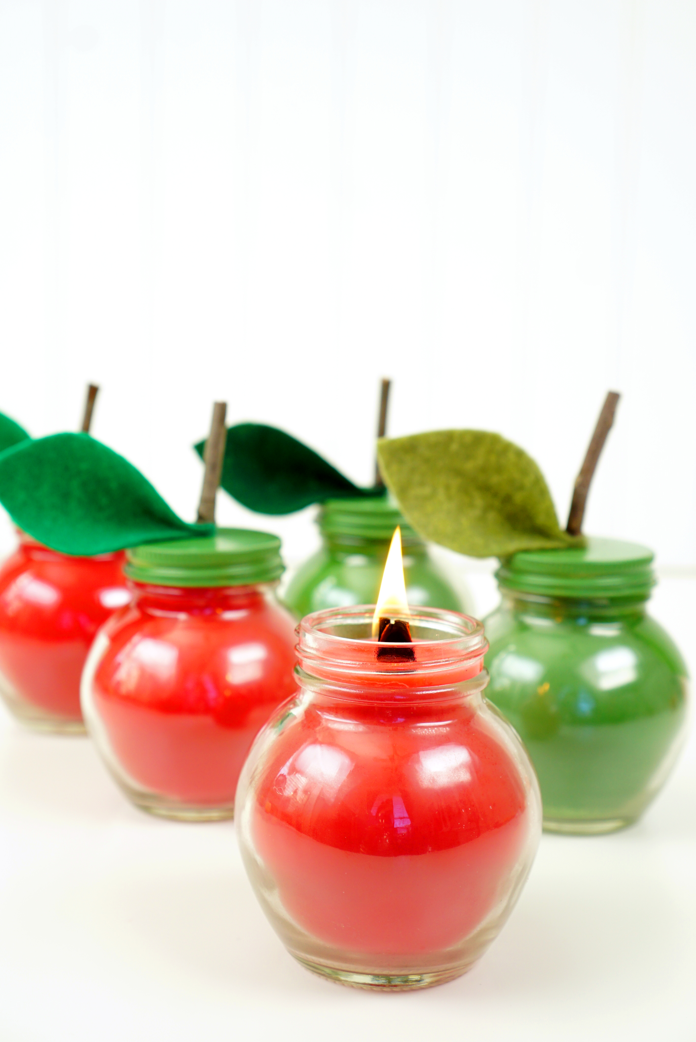 Ever wondered how to make candles? These Easy DIY Apple Spice Candles are super simple to make, and they smell incredible! Makes a great DIY gift idea for friends, family, teachers, neighbors, and more!