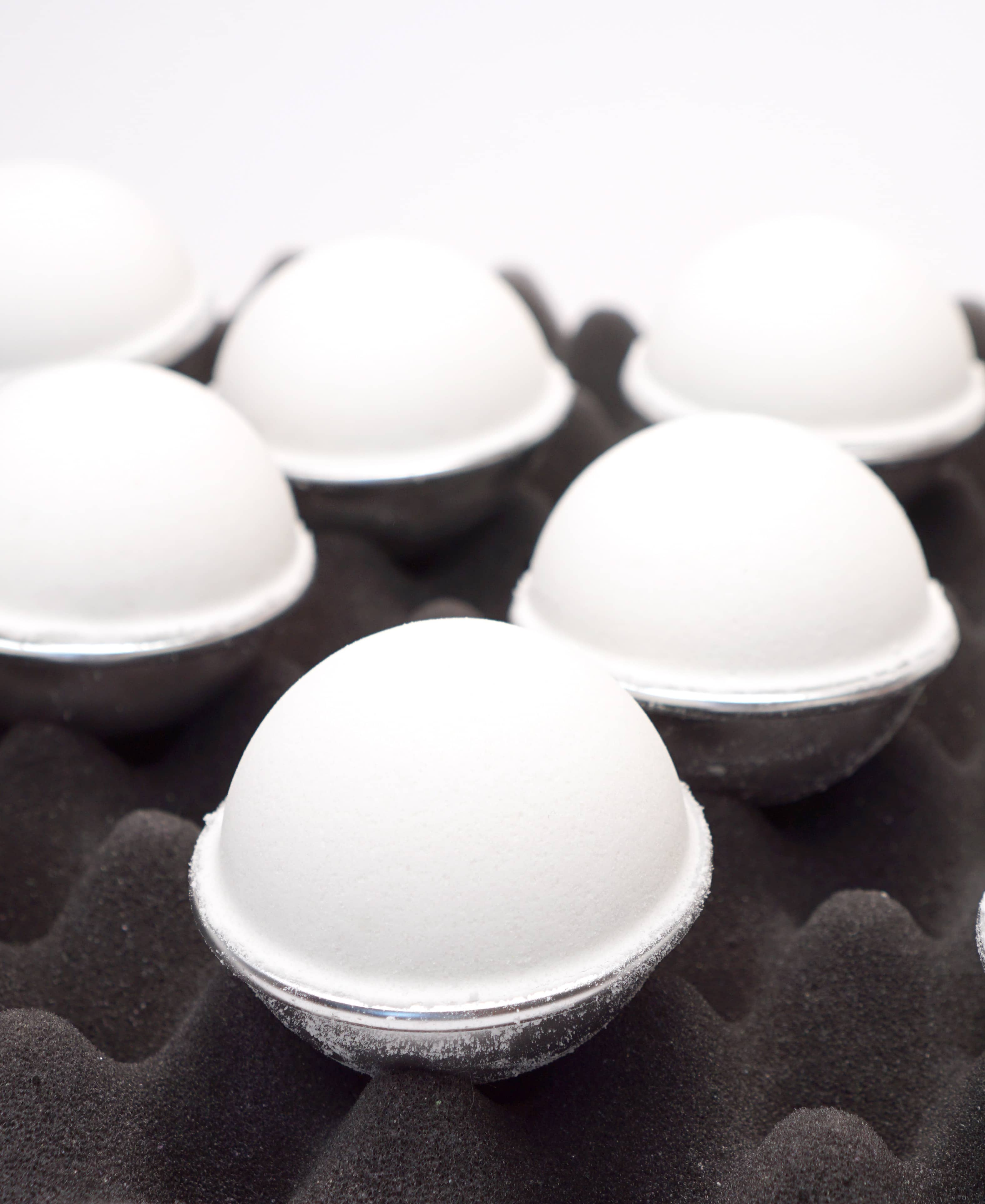 Bath bombs drying on egg crate foam