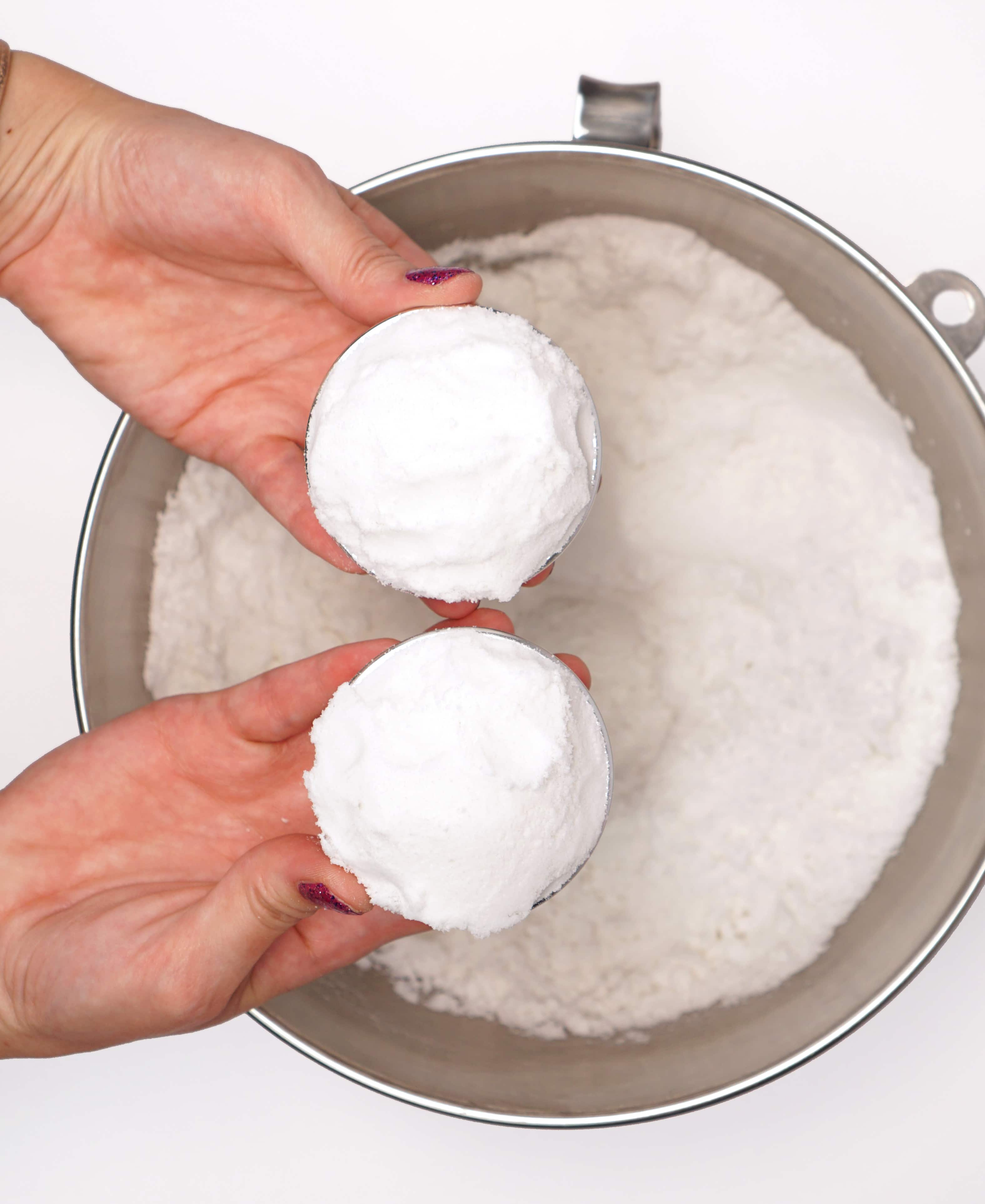 Overfilled halves of a metal bath bomb mold