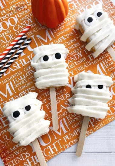 Mummy Rice Krispies Treats on an orange Halloween background