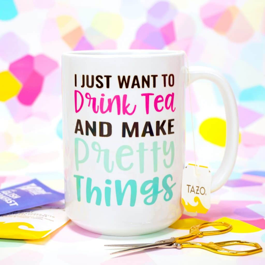 """""""I Just Want to Drink Tea and Make Pretty Things"""" mug made with Cricut Infusible Ink on colorful background"""