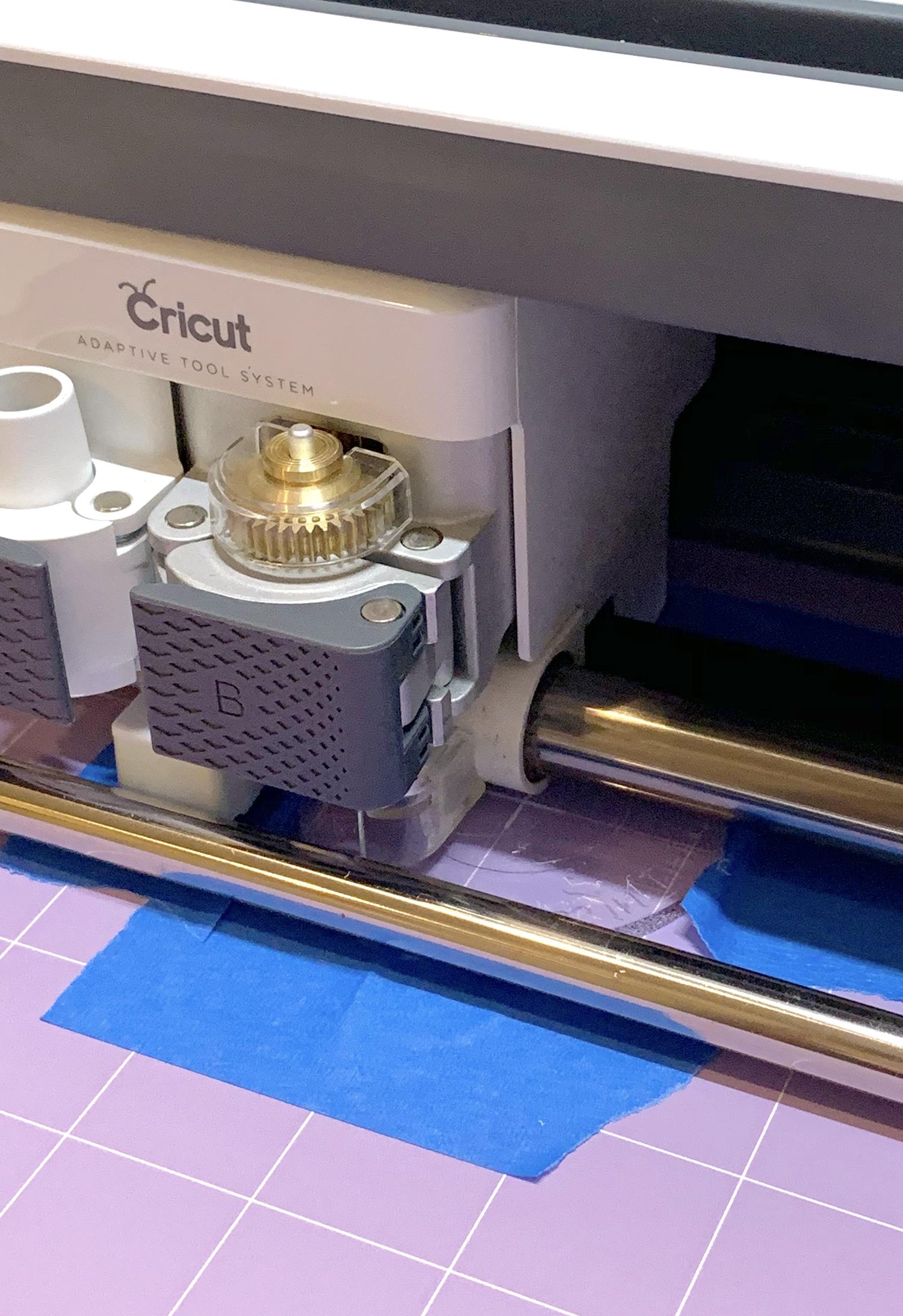 Cricut Maker machine engraving an acrylic disc with the Cricut Engraving Tool Tip