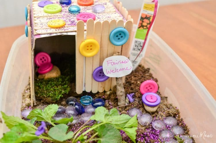 Fairy garden door made of popsicle sticks and decorated with colorful buttons