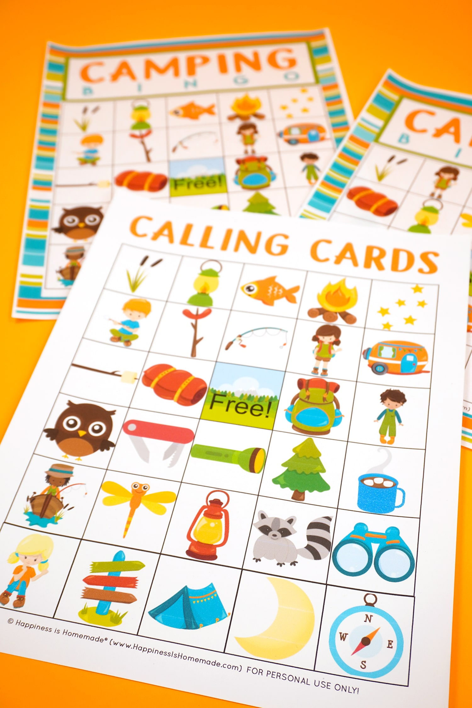 Two Camping Bingo Printable game cards on a n orange background with calling cards