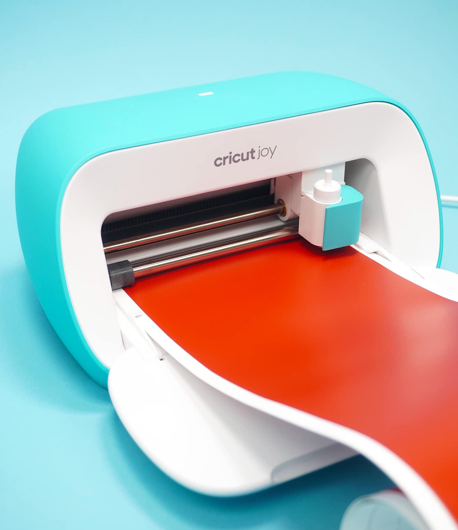 Cricut Joy machine loaded with red Smart Vinyl