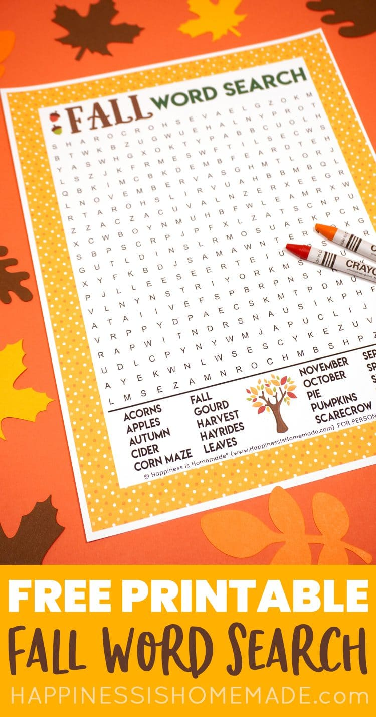 Fall Word Search Printable on dark orange background with orange and red crayons surrounded by paper leaves