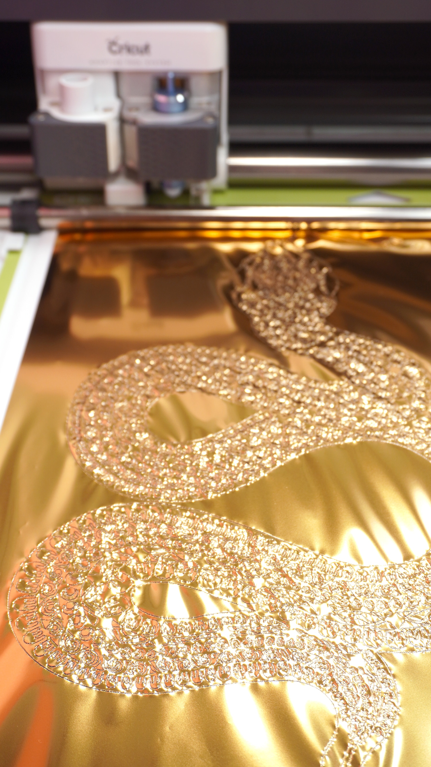 Close up of gold foil transfer sheet with snake design
