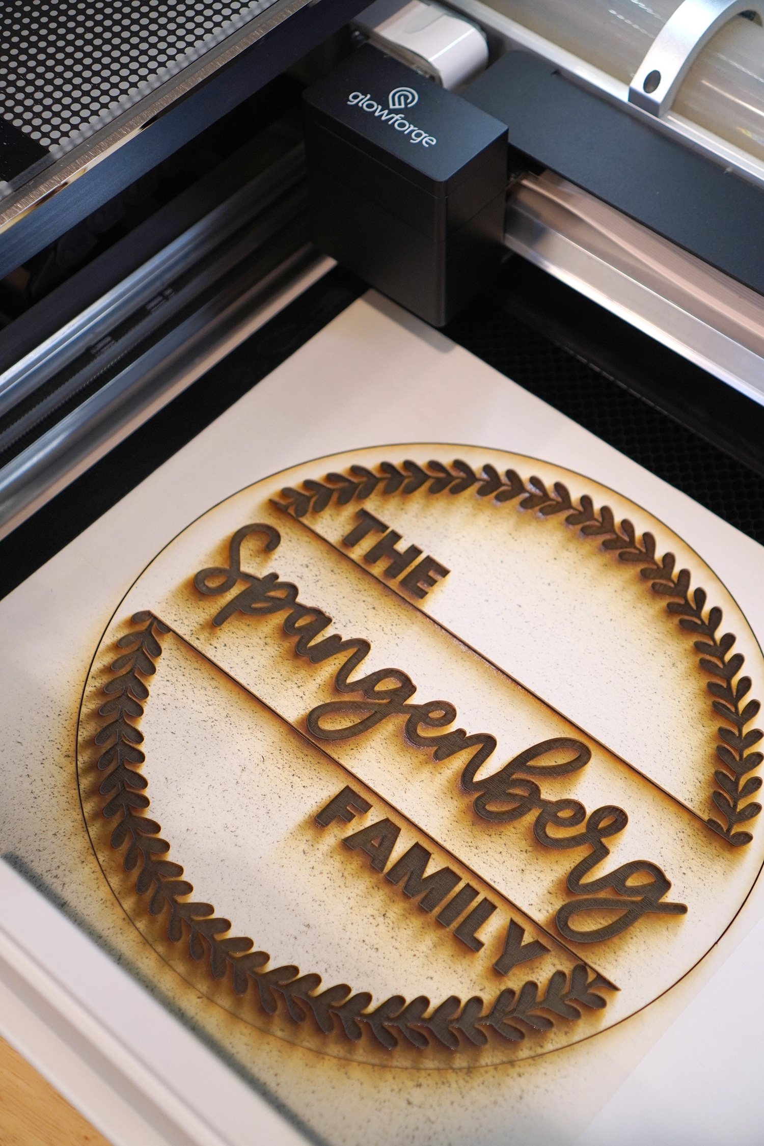 Custom Wood Sign in Glowforge - just finished engraving, still in machine