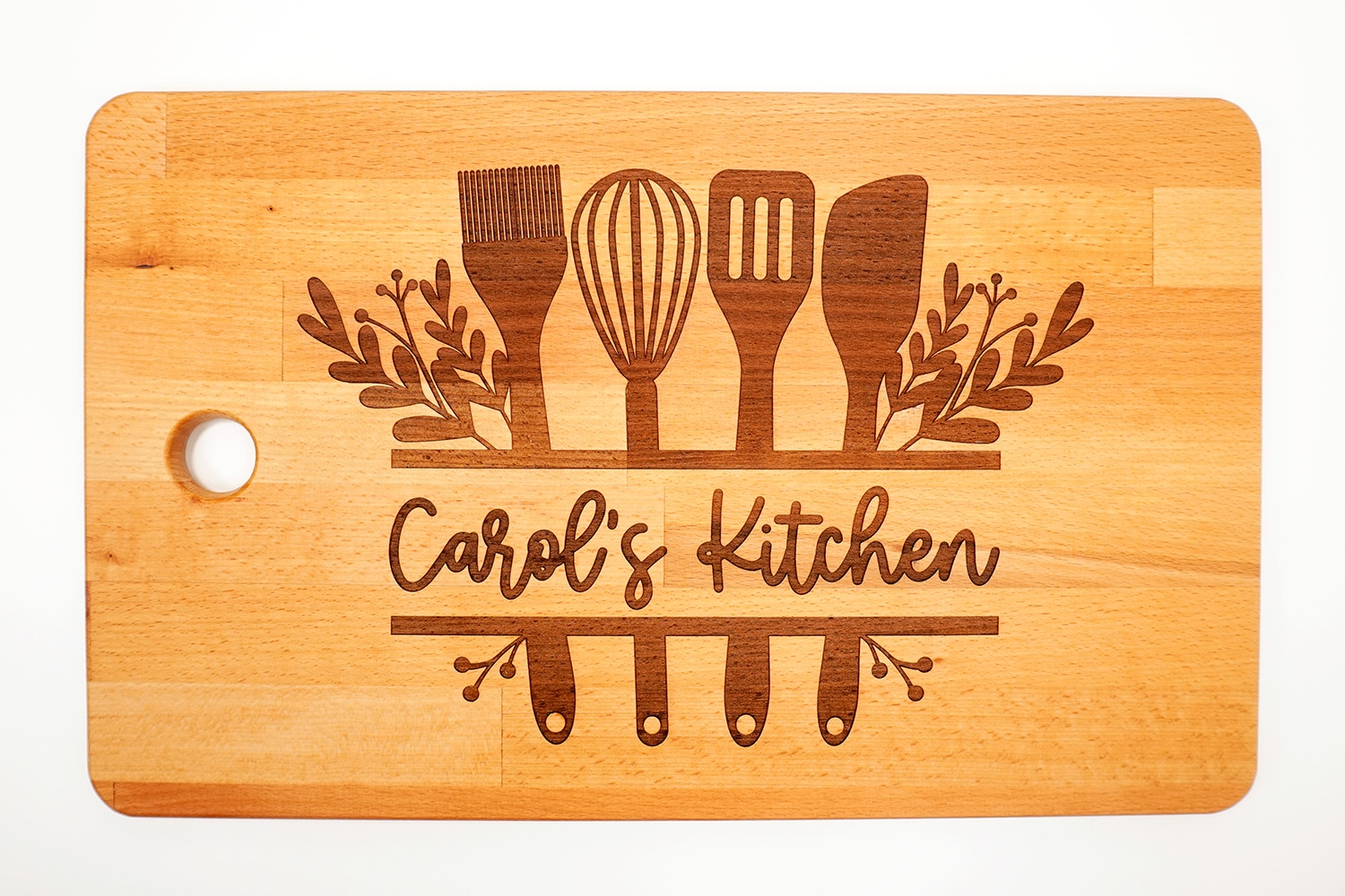 "Glowforge Engraved Ikea Cutting Board with ""Carol's Kitchen"" design on white background"