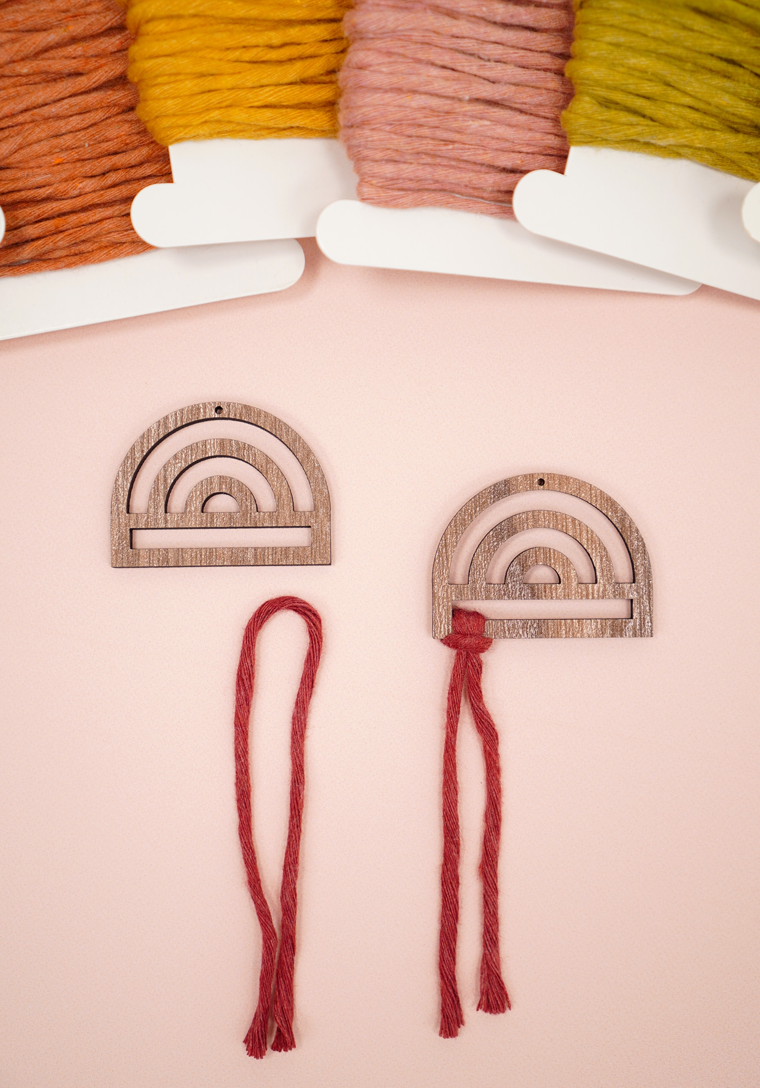 Rainbow Wood Macrame Earring Frames and Cording on peach background