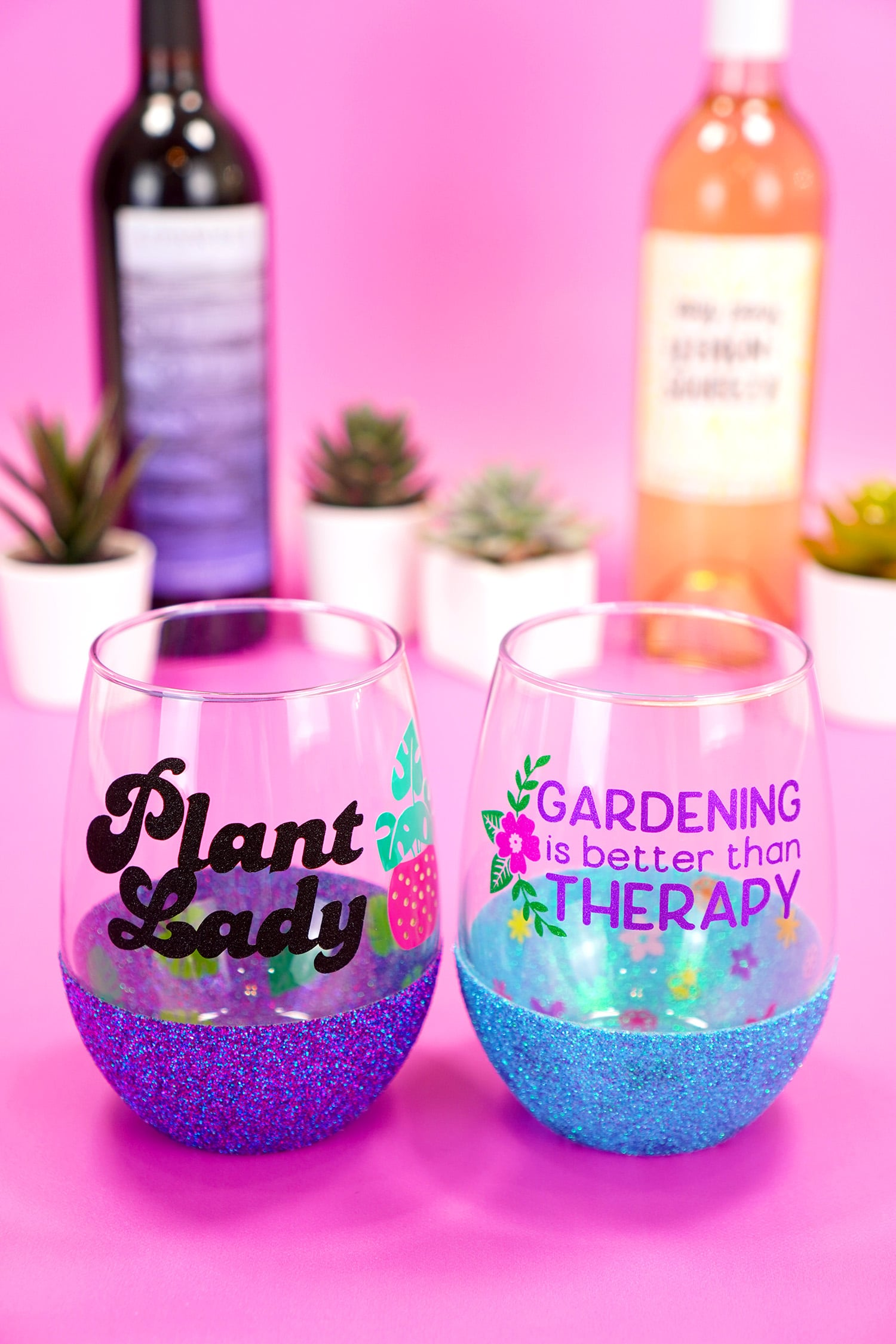 """""""Plant Lady"""" stemless wine glass with purple glitter base and """"Gardening is Better Than Therapy"""" wine glass with blue glitter base"""