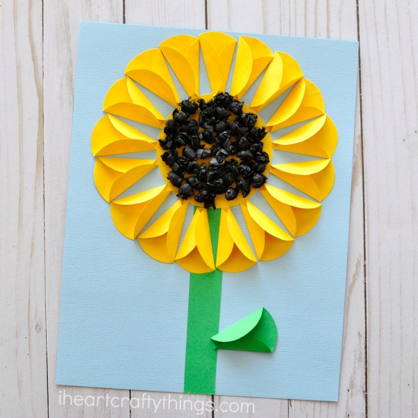 yellow paper sunflower on blue background
