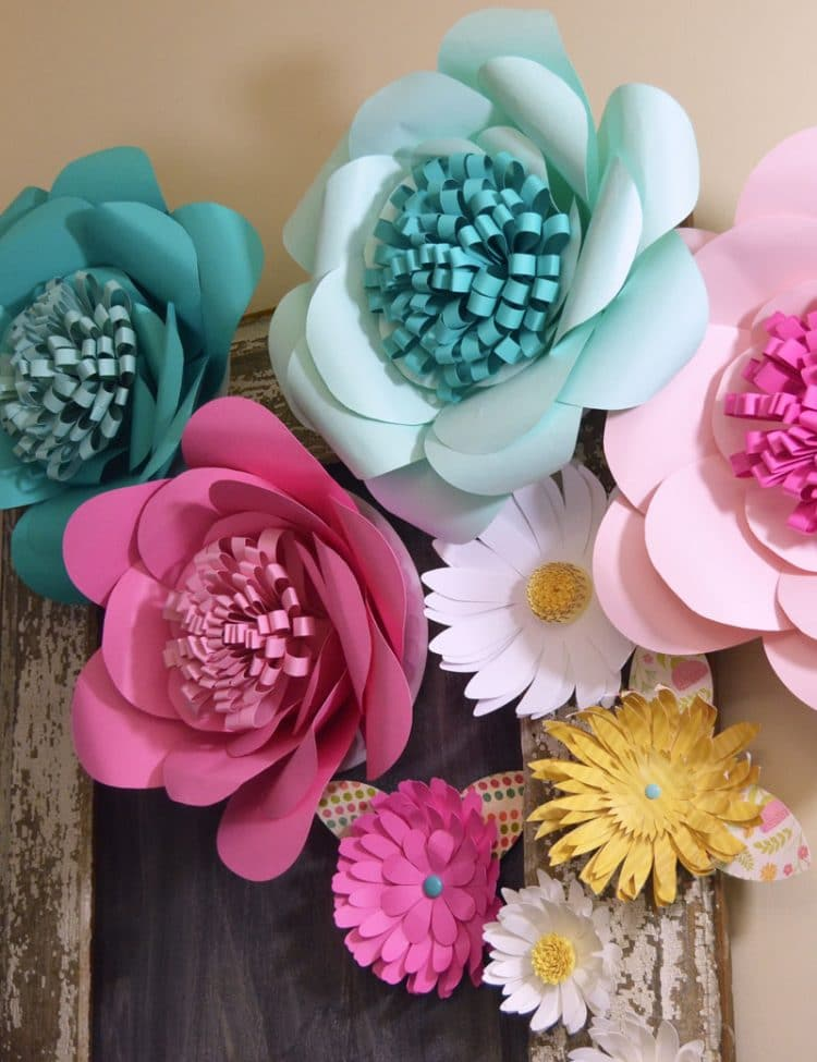 Multiple pink and blue paper flowers