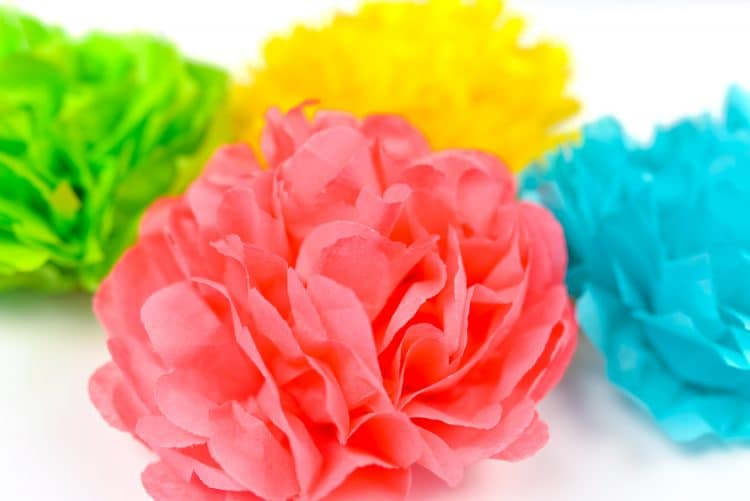 Tissue paper flowers in pink, blue, green, and yellow