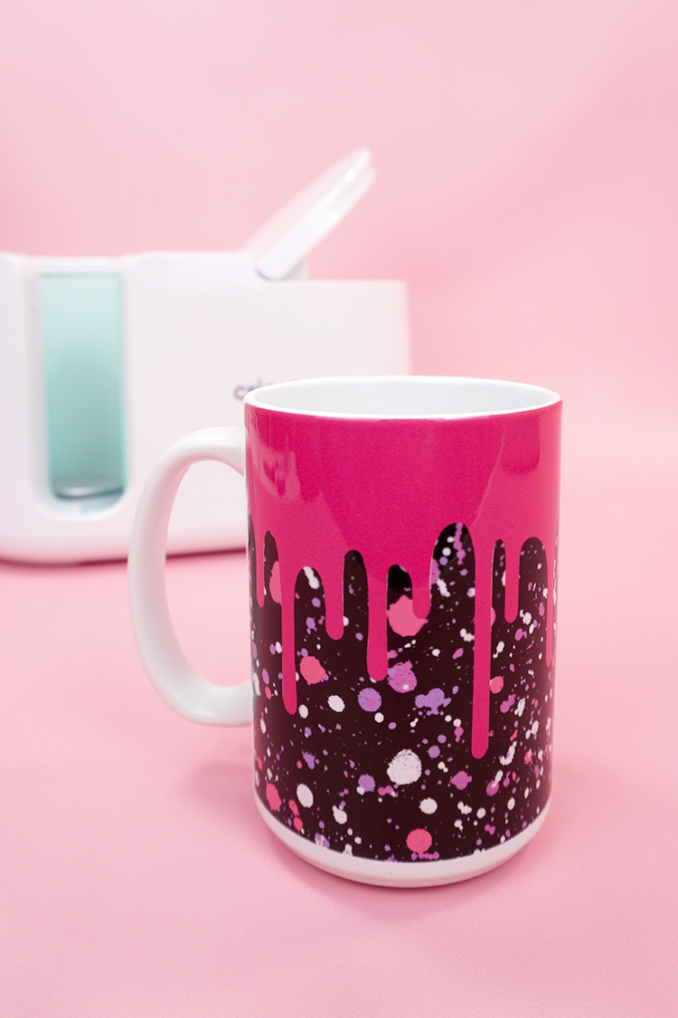 """Pink and black """"drippy"""" Infusible Ink mug on pink background with Cricut Mug Press"""