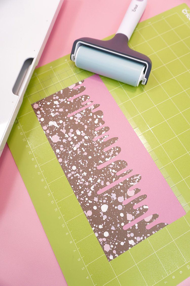 """Two colors of Infusible Ink in a """"Drippy"""" design on a Cricut cutting mat"""