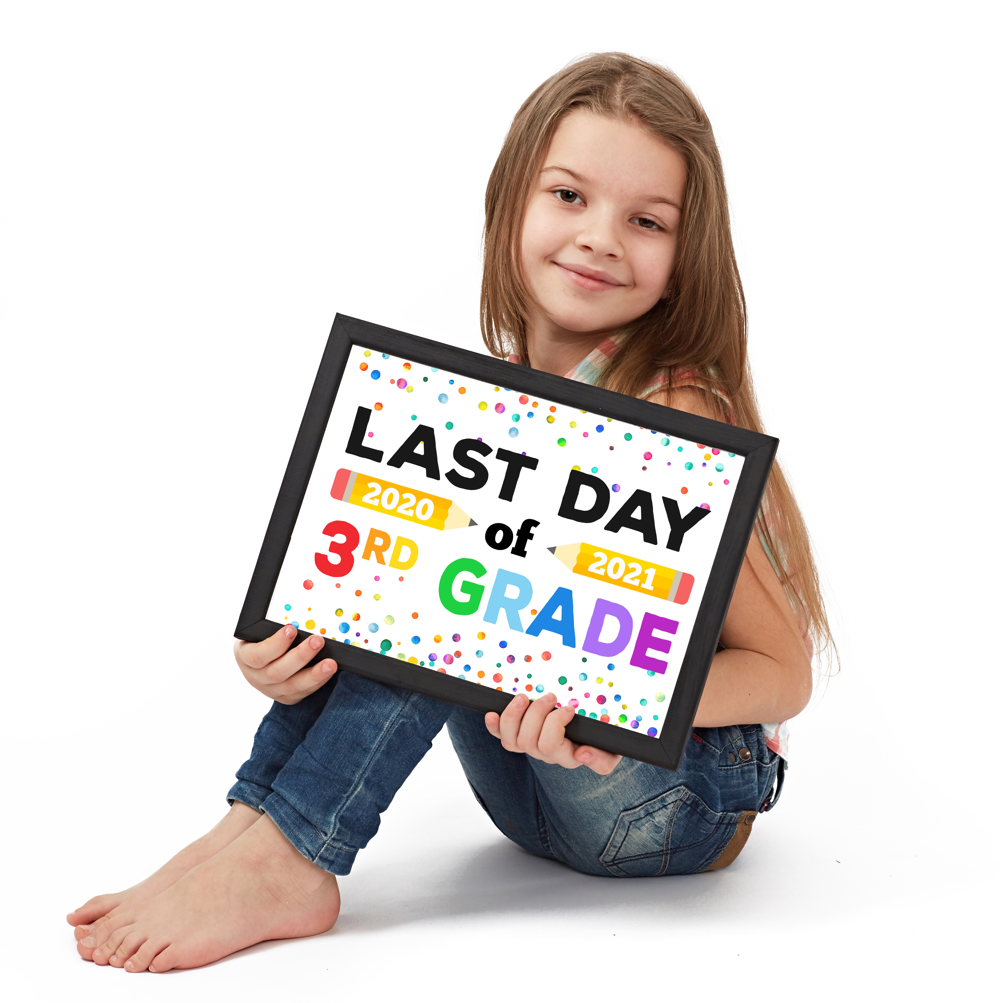 Cute girl holding framed Last Day of School printable sign