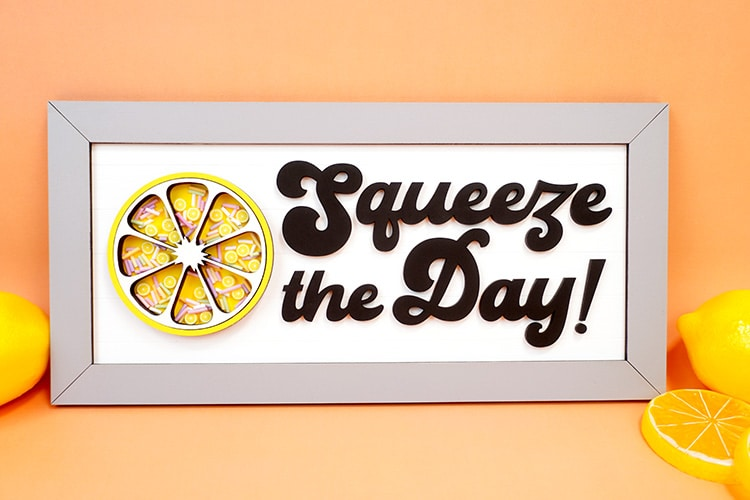 Squeeze the Day laser cut wood sign with shaker embellishments on orange background