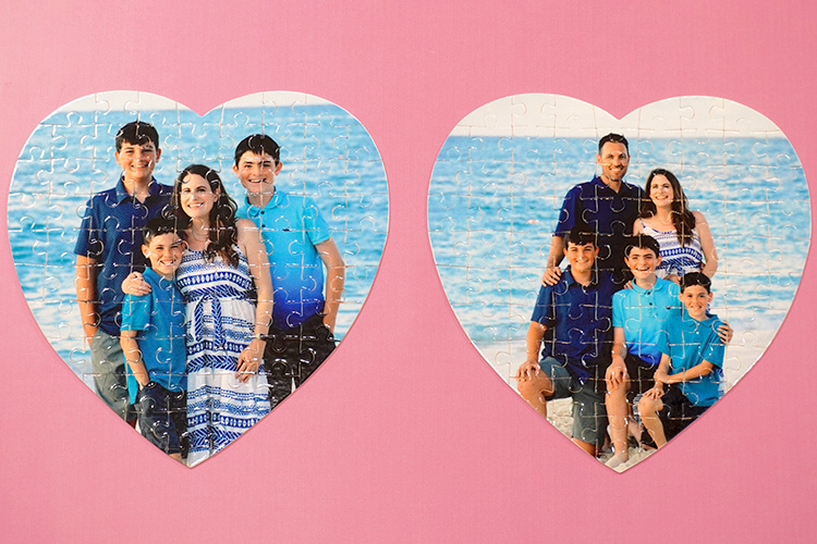 two heart-shaped photo jigsaw puzzles on pink background