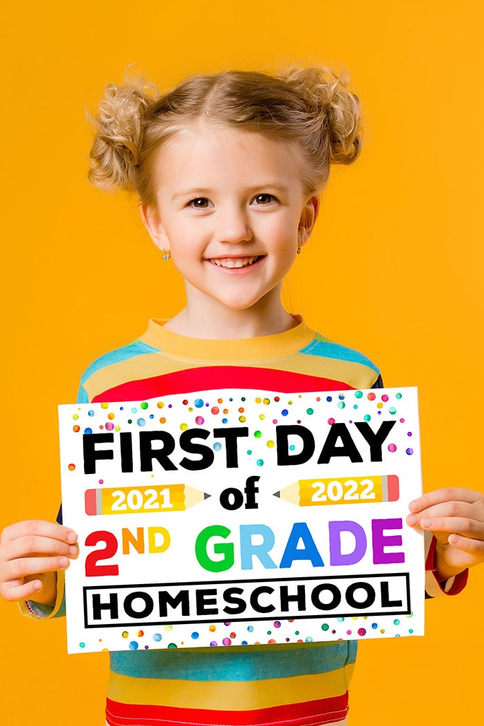 """Cute blonde girl holding a free printable """"First Day of Homeschool 2021-2022"""" sign on an orange background"""