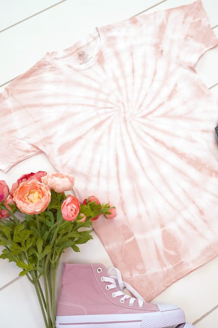 Close up of spiral tie-dye t-shirt made with avocado pit dye