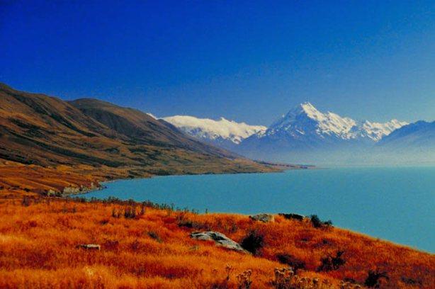 beautiful photo of land sea & mountain