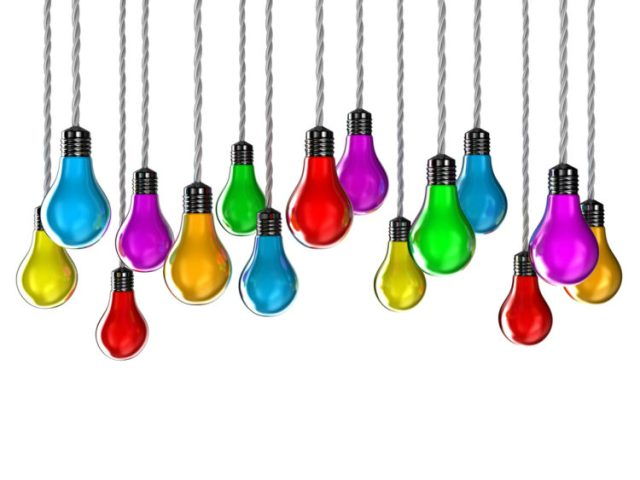 A rainbow of brightly lit hanging lightbulbs represents flourishing nonprofits.