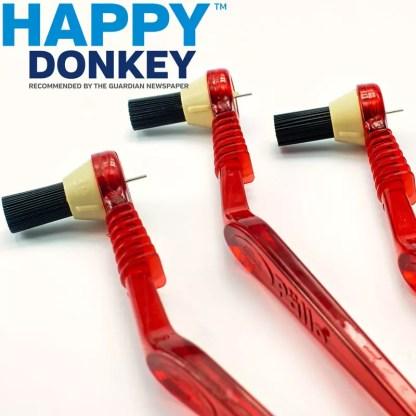 Three red Pallo brushes