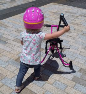 Toddler with tricycle