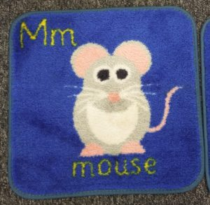 Carpet tile with mouse and letter M