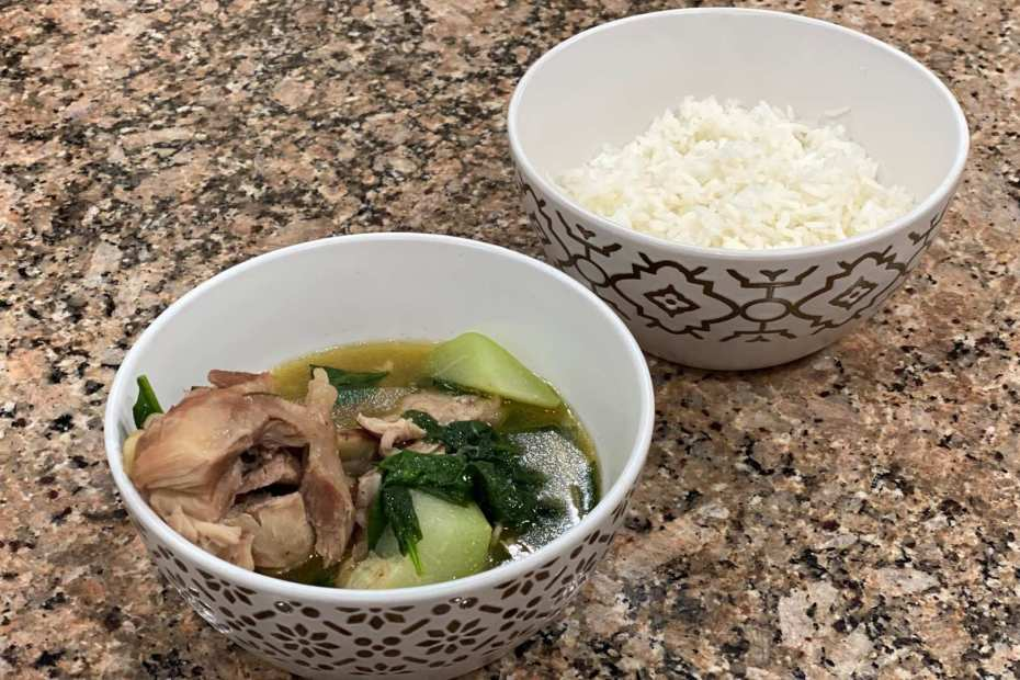 A bowl of Tinolang Manok with white rice on the side