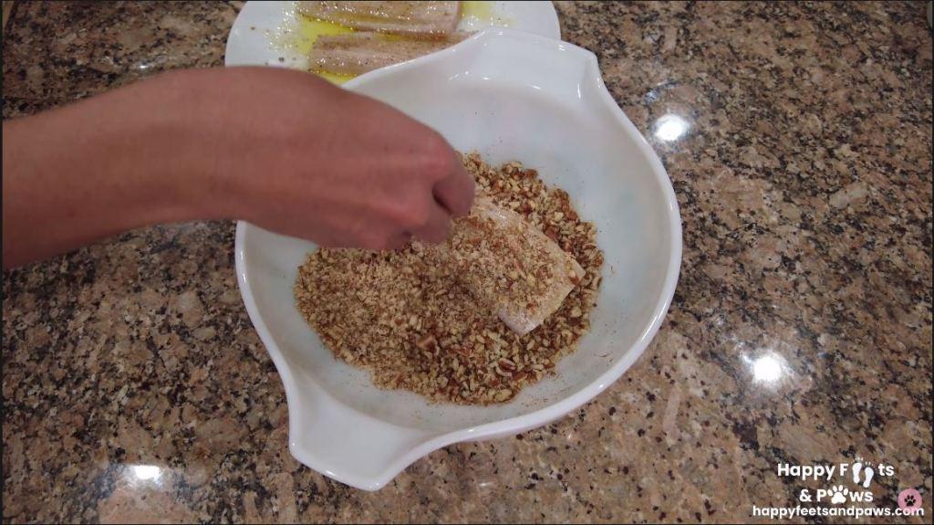 breading mahi mahi fish in bowl