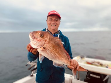 happy-fisherman-fishing-mud-island tibby flora