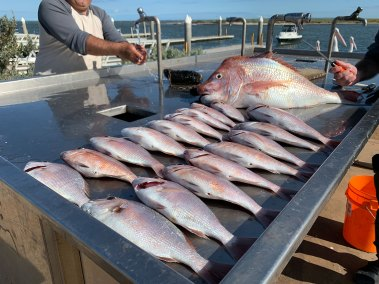 happy-fisherman-fishing-mid-port-phillip-bay