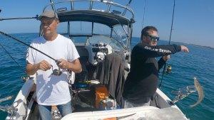 happy fisherman fishing witing