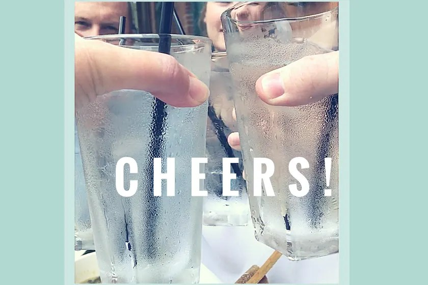 Toasting glasses with text 'cheers""