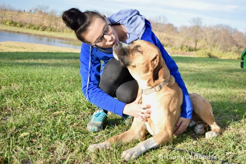 Trainer Bella kisses dog in training at Warriors' Best Friend