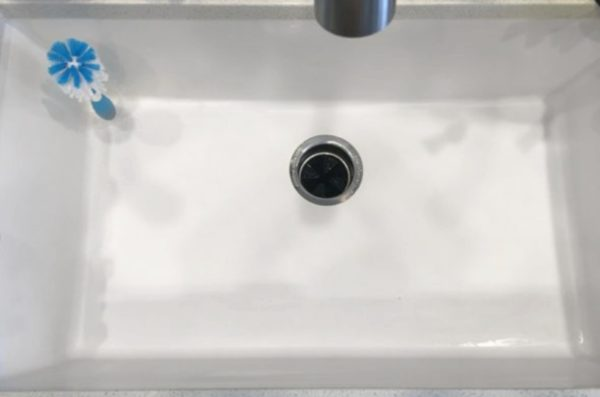 see the difference in the clean white sink after using these three ingredients