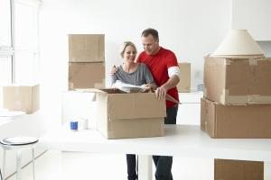 couple packing up their things into a box