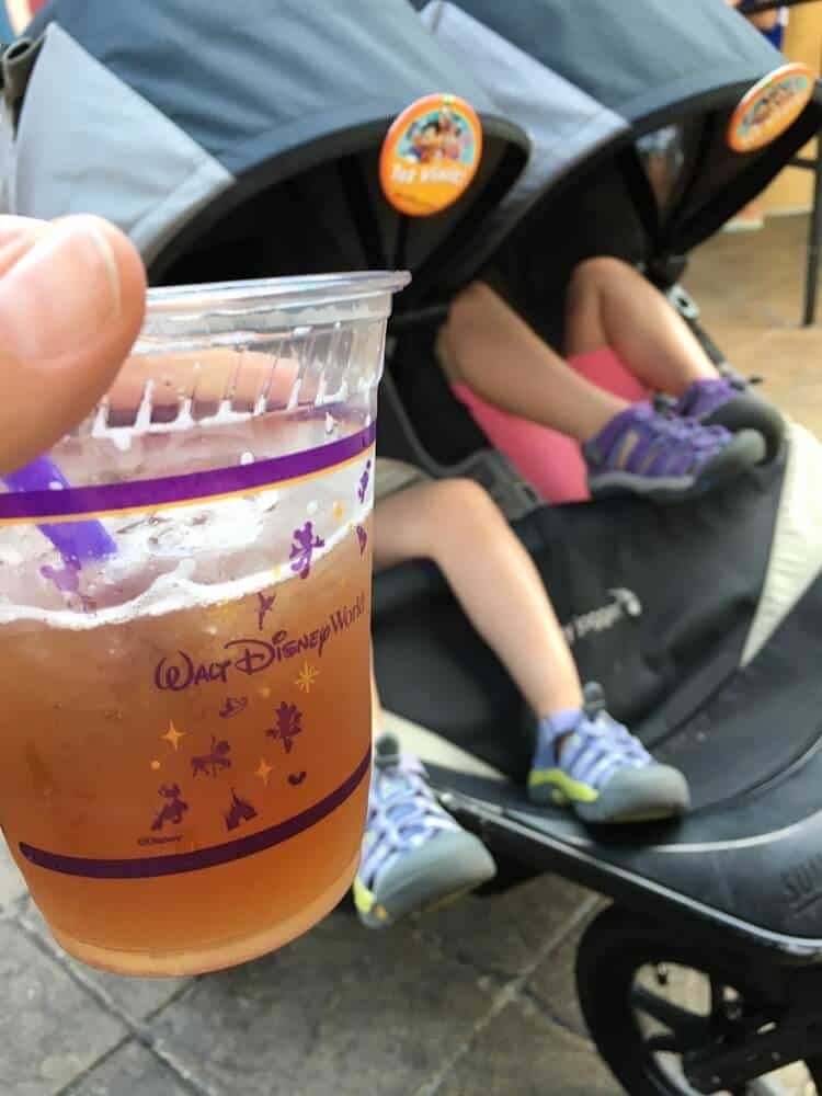 Drinking an alcoholic beverage at Epcot.   Last Minute Disney World Vacation   Disney World Family Vacation   Disney World Planning   Disney World Tips and Tricks