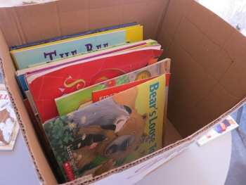 A box of donated used books. Places where you can donate used books.