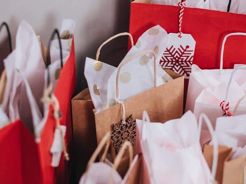 Many Christmas gift bags.