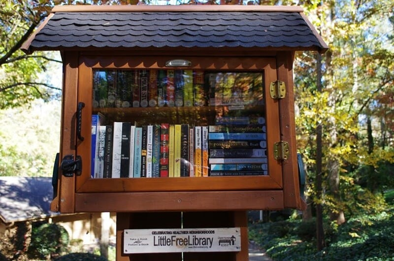 See up a free lending library through Little Free Library as a way to donate used books. Here is a little free library in GA.