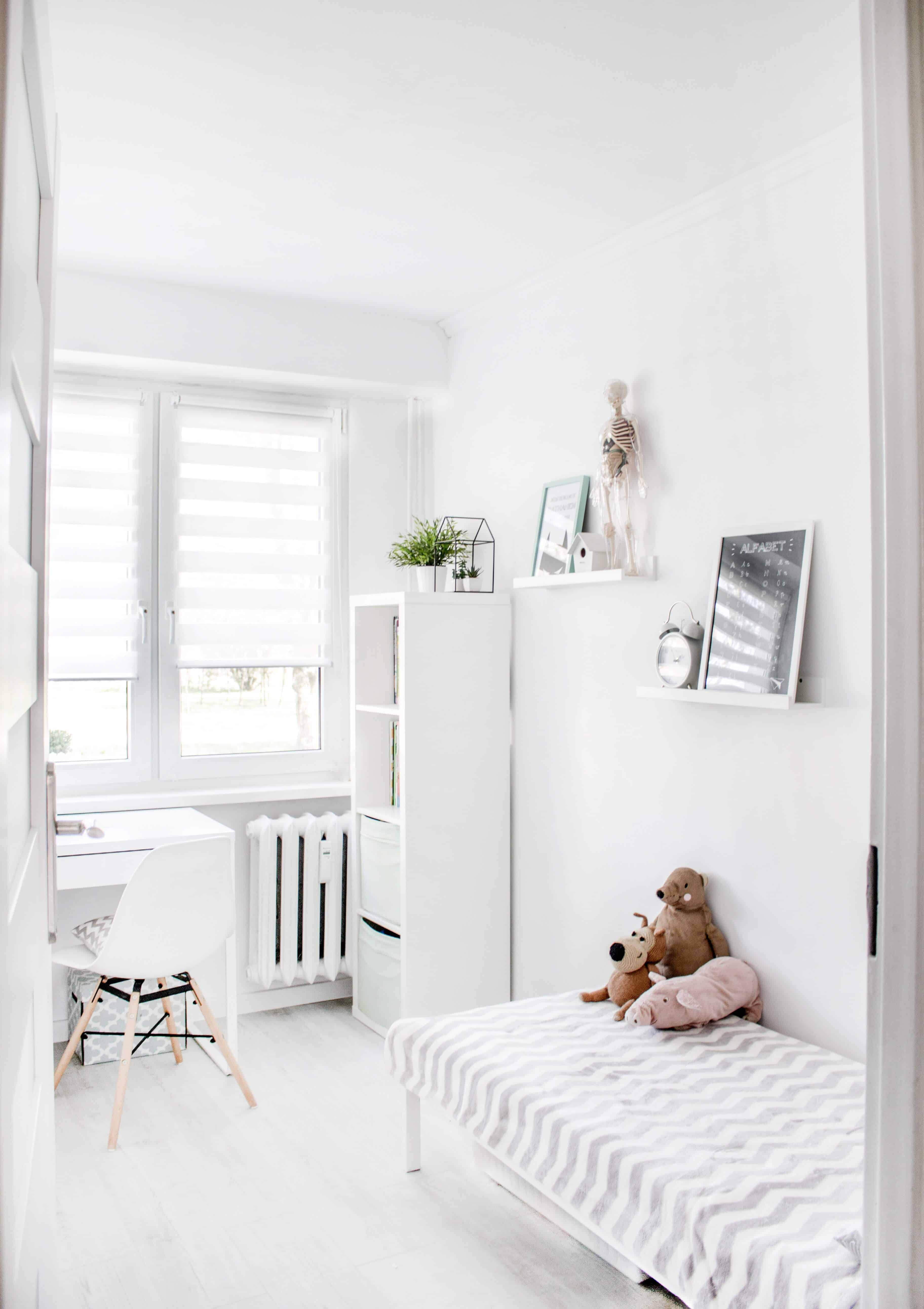 A very clean minimalist child's room, in all white.
