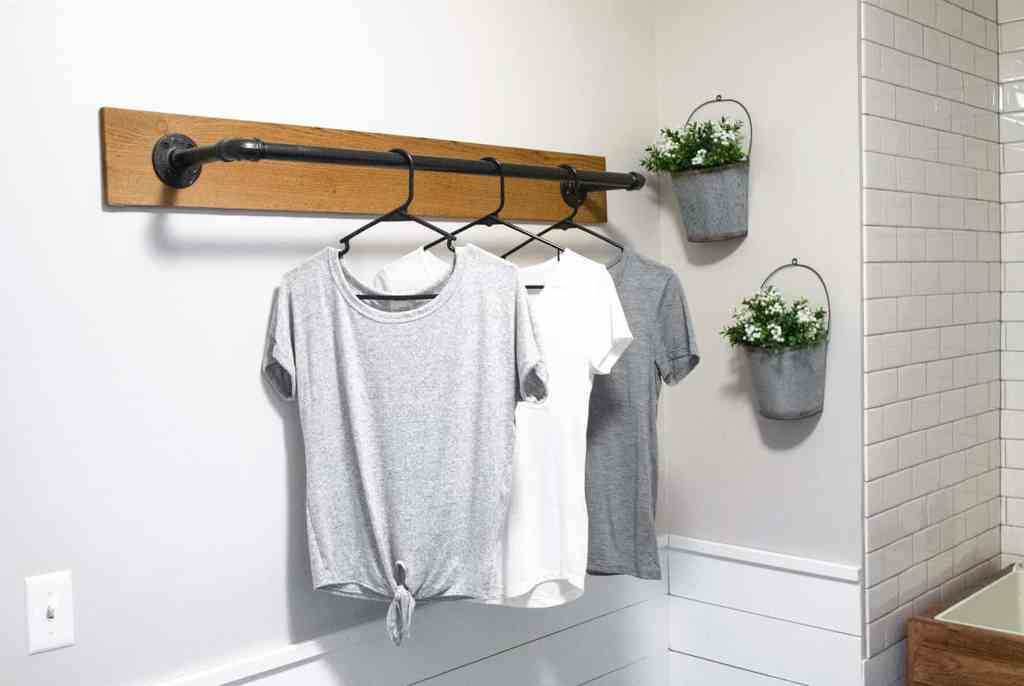 Wall mounted clothing rack you can install in your laundry room.